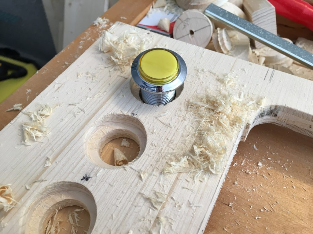 The LED arcade buttons were first sunk with a 50mm Fostner drill and then the hole drilled with a 35mm round drill. The edges are later mirrored around.